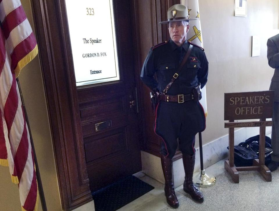 A Rhode Island state trooper stood outside the office of House Speaker Gordon Fox on Friday.