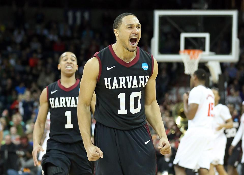 Brandyn Curry (right) and Siyani Chambers celebrated after Harvard beat Cincinnati in the second round of the NCAA Tournament.