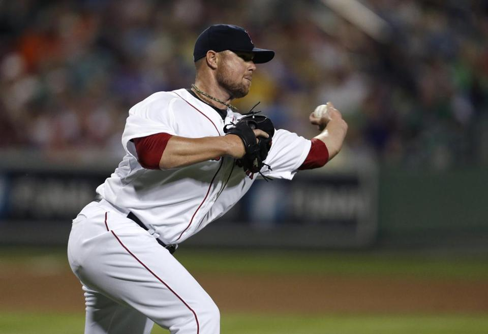 "Jon Lester calls starting on Opening Day ""a huge honor."" (AP Photo/Gerald Herbert)"