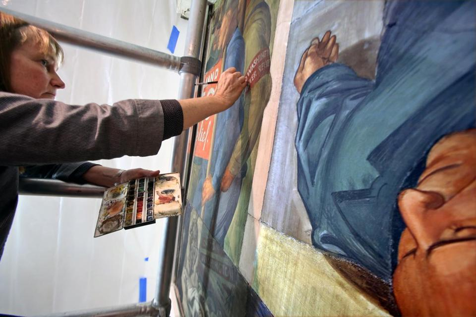 "Teri Hensick, conservator of paintings, worked on the ""Hunger March"" fresco for the Harvard Art Museums in Cambridge."
