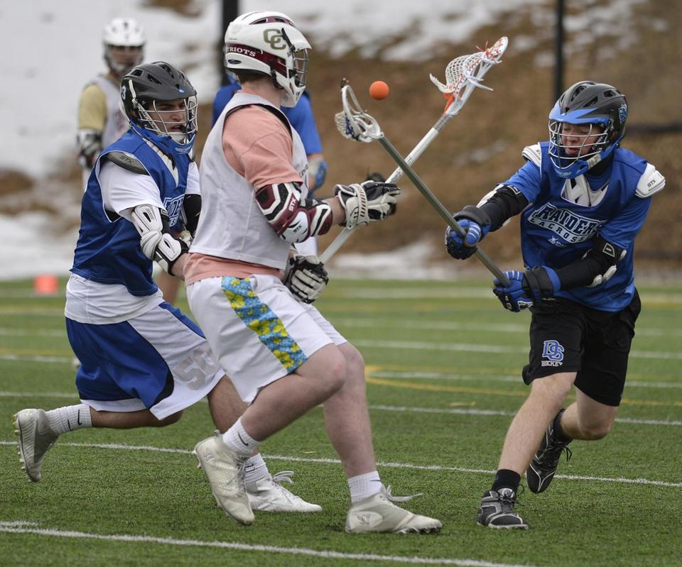 Dover-Sherborn (in blue) and Concord-Carlisle players challenge each other during a weekend scrimmage.