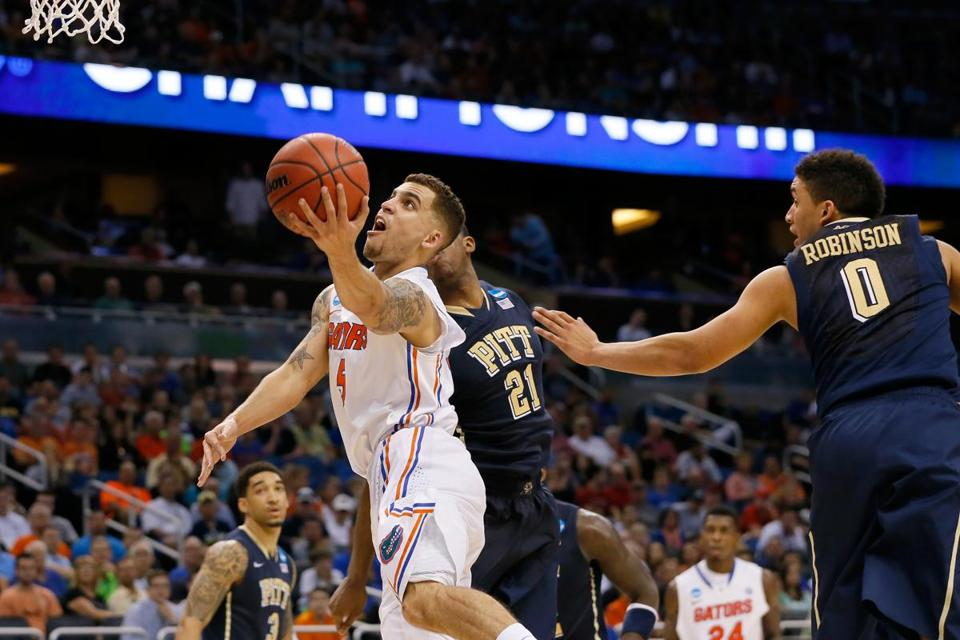 Scottie Wilbekin of Florida went up for a shot against James Robinson and Lamar Patterson of Pittsburgh.