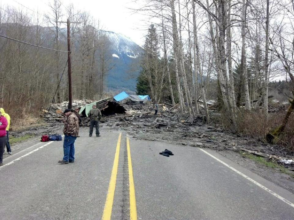 Emergency workers responded to the scene of the mudslide in Oso, Wash.