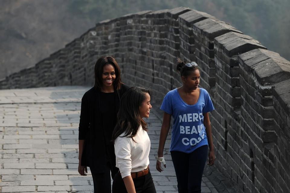 Michelle Obama walked along the Great Wall of China with her daughters Malia and Sasha (right) on Sunday.