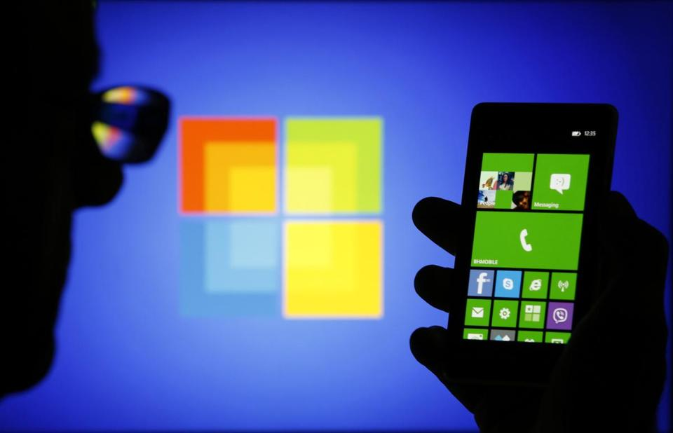 Microsoft plans to be a more aggressive direct competitor against Apple and Samsung, the smartphone leaders.