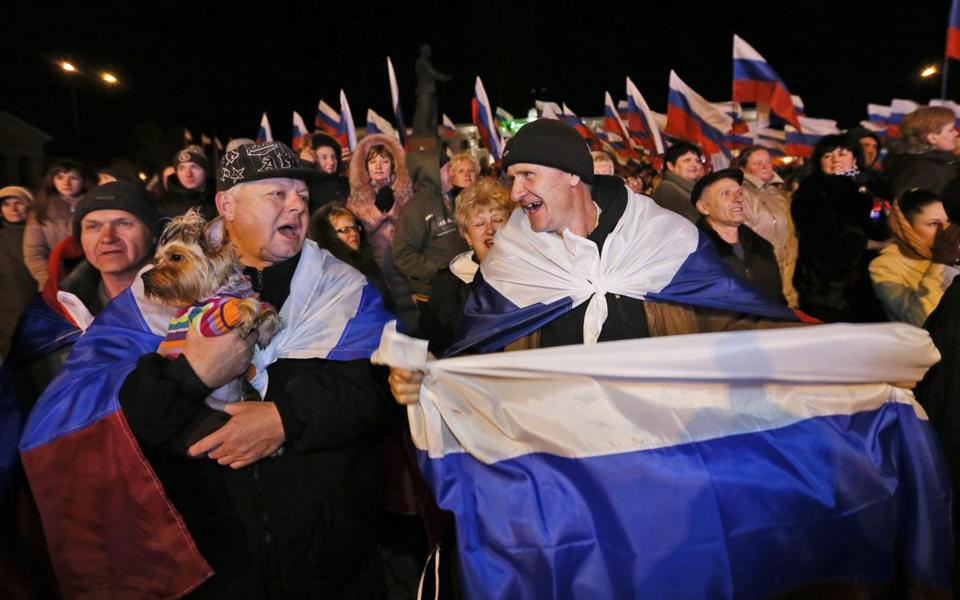 People celebrate in Lenin Square in Crimea on March 16 after more than 95 percent of Crimeans voted for the Ukrainian region's accession to Russia.