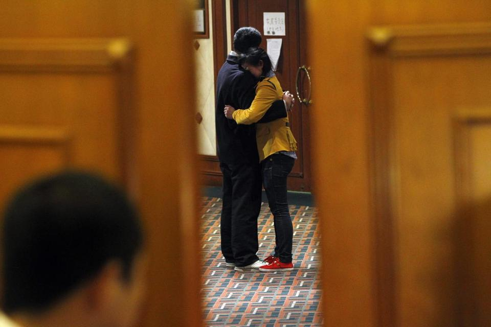 Relatives of passengers of missing Malaysia Airlines flight MH370t embraced at a hotel in Beijing after hearing the news from Kuala Lumpur.