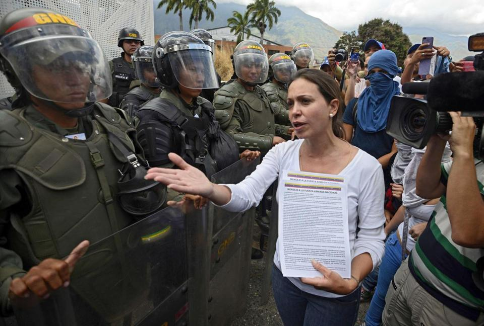 Opposition deputy Maria Corina Machado talked to members of the National Guard during a protest on March 16.