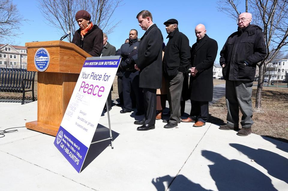 The Rev. Liz Walker opened the gun buyback news conference Monday with a prayer at Dr. Loesch Family Park in Dorchester. Mayor Martin J. Walsh of Boston was to her left.