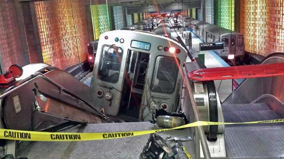 A Chicago Transit Authority train car rests on an escalator at the O'Hare Airport station after it derailed early on Monday.