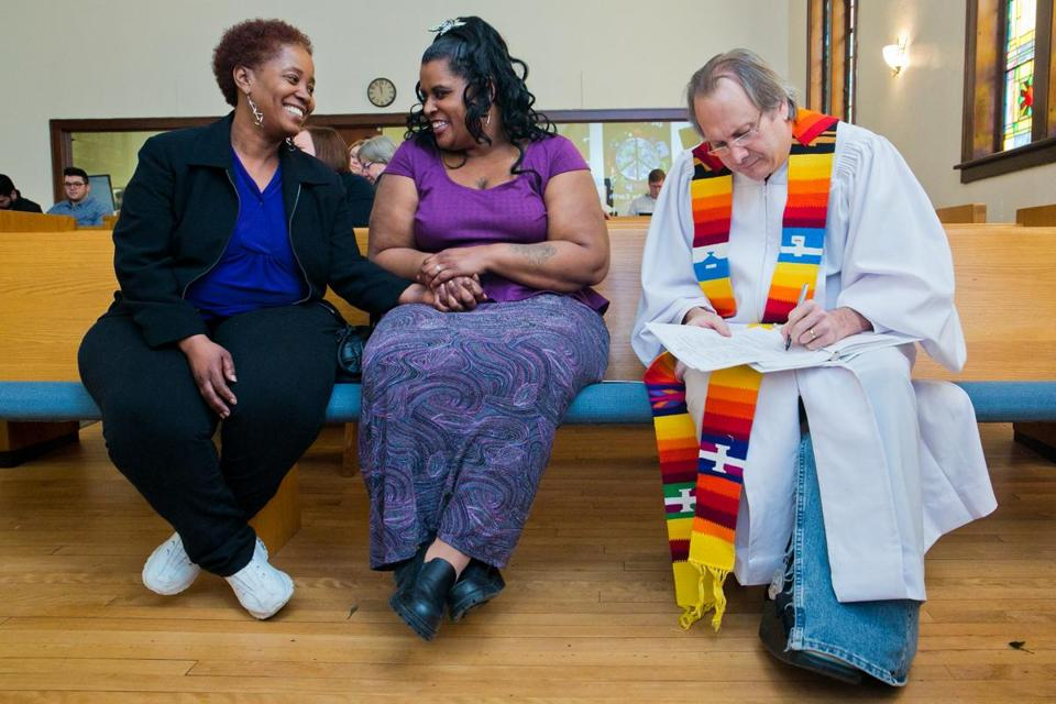 Renecia Hall and Kristen Martin awaited their marriage license from the Rev. Bill Freeman at a Unitarian Universalist church in Muskegon, Mich., on Saturday.