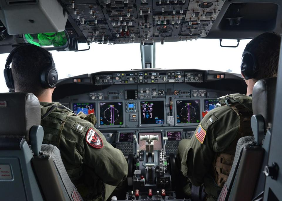 This Navy handout image shows naval aviators piloting a P-8A Poseidon in the search for the Malaysian flight over the Indian Ocean.