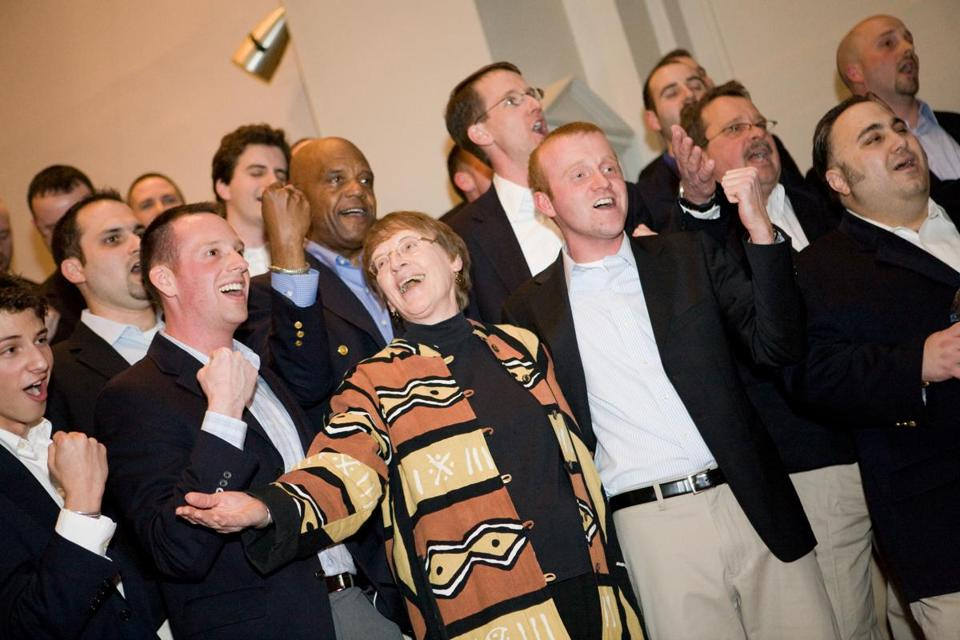 At a reunion concert in 2008, Sue Alexander, dean of students emeritus, joined in singing a few numbers with the Gentlemen Callers who returned to Wheaton College.