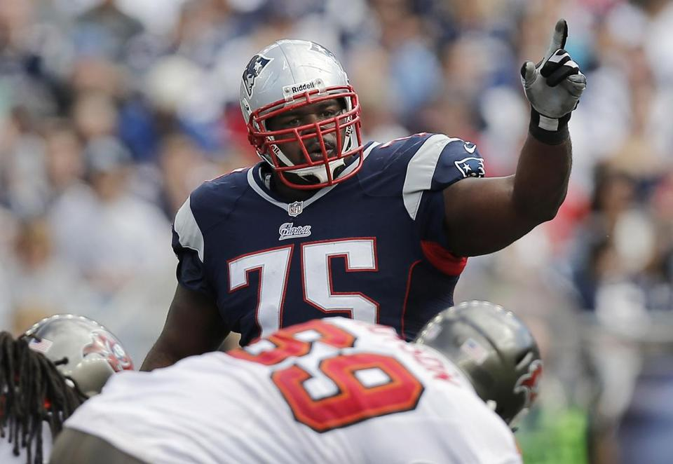 Vince Wilfork is balking at a pay cut, which has him and the team at a standoff. (Photo by Winslow Townson/Getty Images)