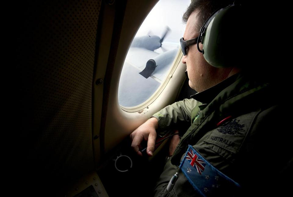 Warrant Officer Nicholas Harding with the Australian Air Force looked out from a AP-3C Orion aircraft as it flew over the southern Indian Ocean.