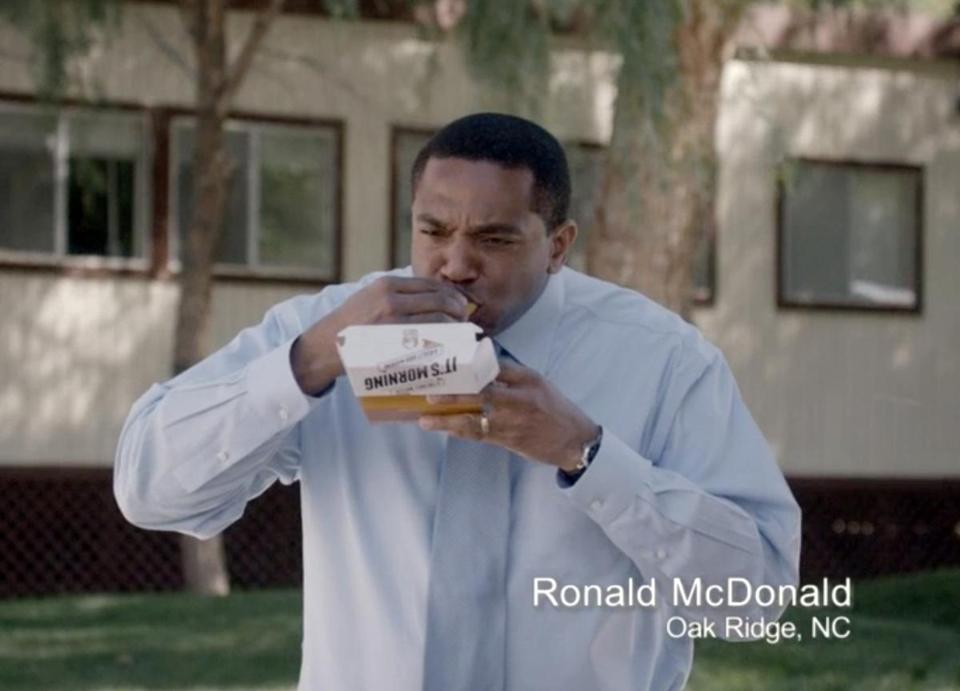 This image captured from a Taco Bell television ad shows one of the Ronald McDonalds eating a breakfast menu item.