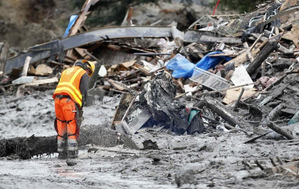 The debris field is about a square mile and 40 feet deep in places, and poses an array of hazards to rescue workers.