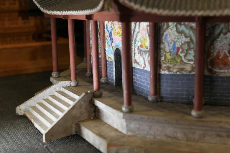 Scale models of Buddhist pagodas were made a century ago by Chinese orphans. Three of the rediscovered models are on display this month in Boston College's O'Neill Library
