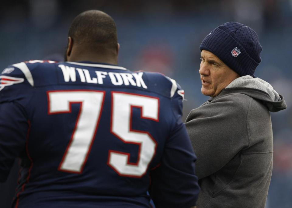 Vince Wilfork will be staying alongside coach Bill Belichick and the rest of the Patriots.