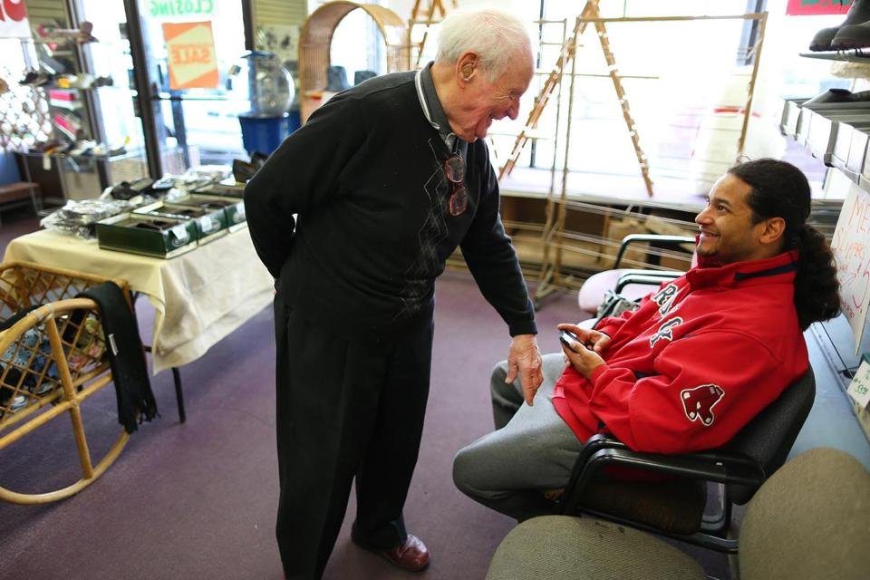 Al's Shoe Store owner Henry Wein chatted with customer Noel Santiago of Revere. The East Boston store is closing.