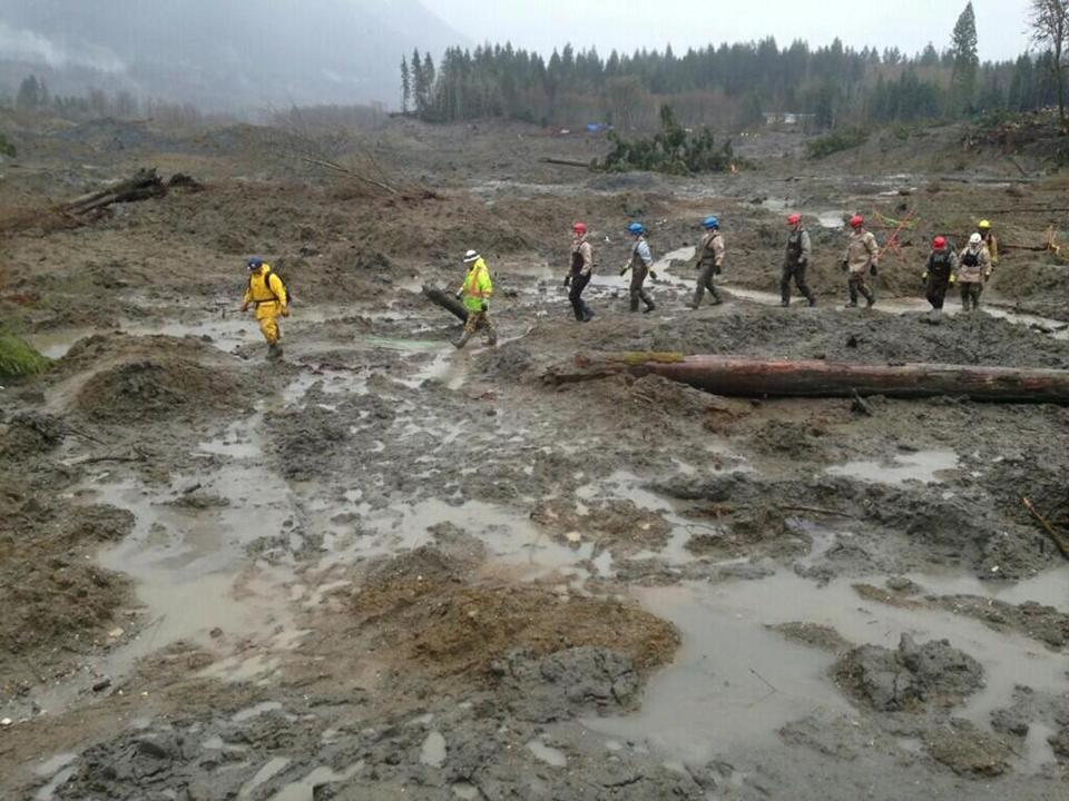 Members of  the Washington National Guard joined civilian workers in efforts to find missing persons following a deadly mudslide in Oso, Wash.