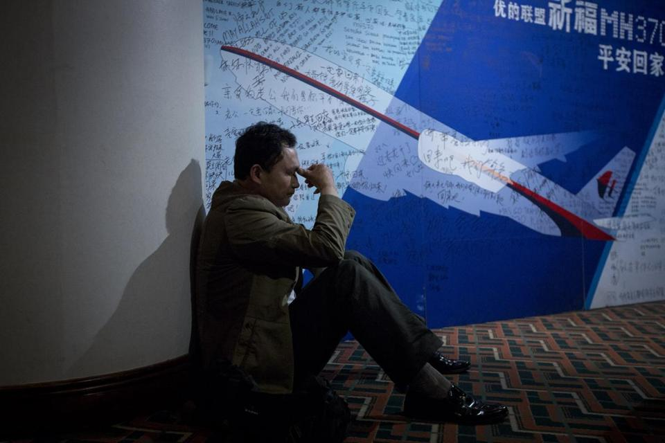 For relatives of passengers on the missing plane, the search drags on and the frustration grows. A relative rested near a board bearing written wishes Saturday in a Beijing hotel.