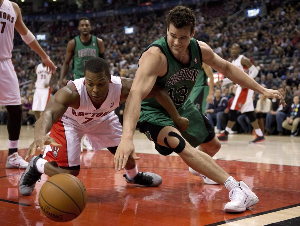 Raptors guard Kyle Lowry and Celtics forward Kris Humphries scrambled for a loose ball during the first half.
