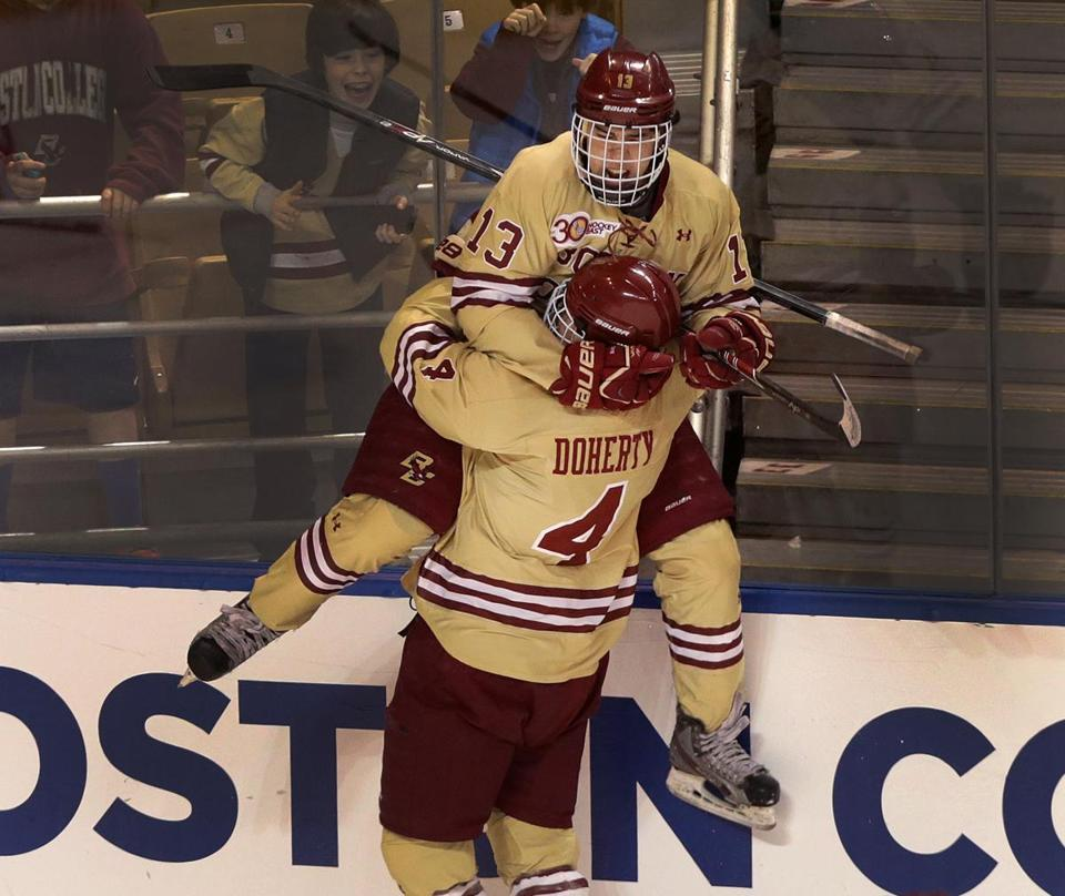Johnny Gaudreau (13) celebrated with teammate Teddy Doherty (4) after scoring the second of his two first-period goals.