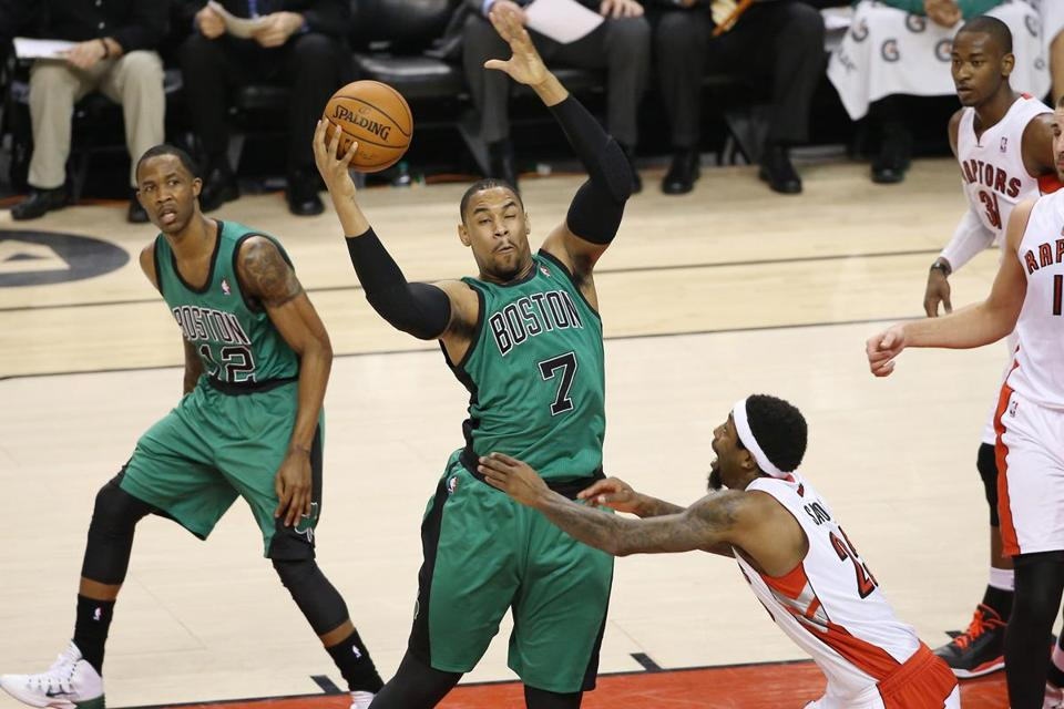 Celtics forward Jared Sullinger tried to hang on to the ball against the Raptors.