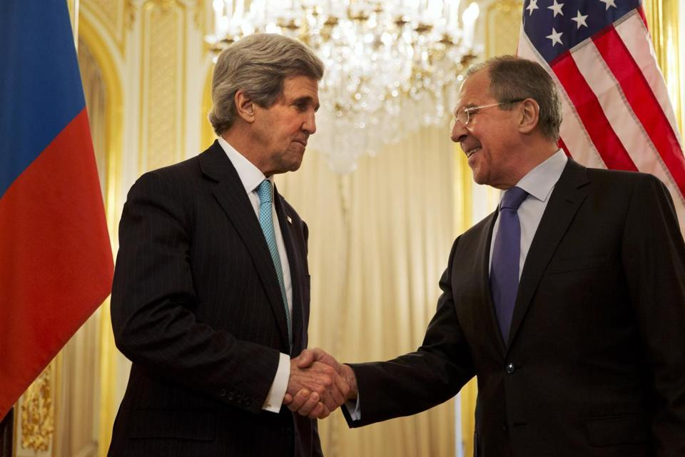 Secretary of State John Kerry, left, shook hands with Russian Foreign Minister Sergey Lavrov before their meeting at the Russian Ambassador's residence in Paris.