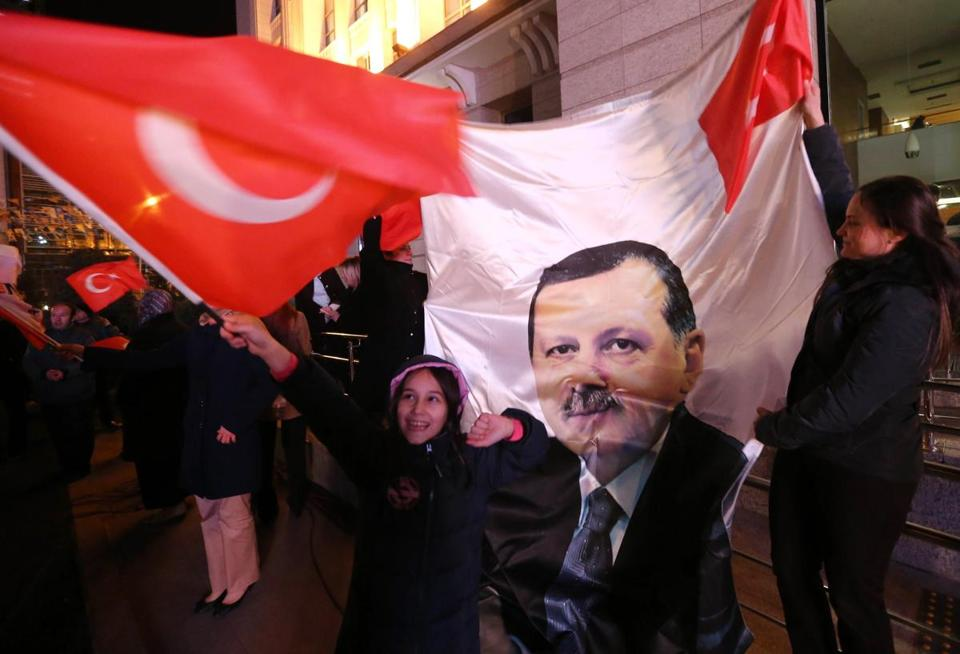Supporters of Turkey's ruling party waved flags, including this one with a picture of Prime Minister Recep Tayyip Erdogan, as they followed election results in Ankara Sunday.