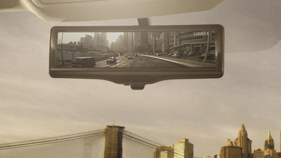 The Nissan Smart Rearview Mirror can show a video feed of what is happening behind the vehicle. The new rule aims to save lives and prevent injuries due to vehicle backups.