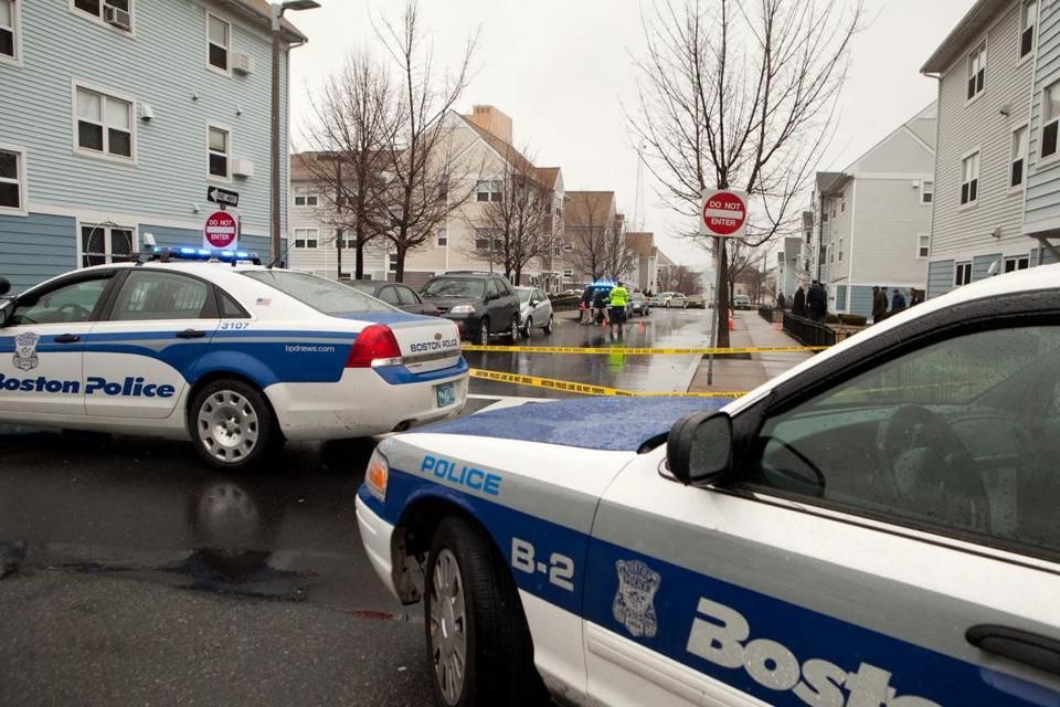 Police investigated the scene of a shooting in Mission Hill in March.