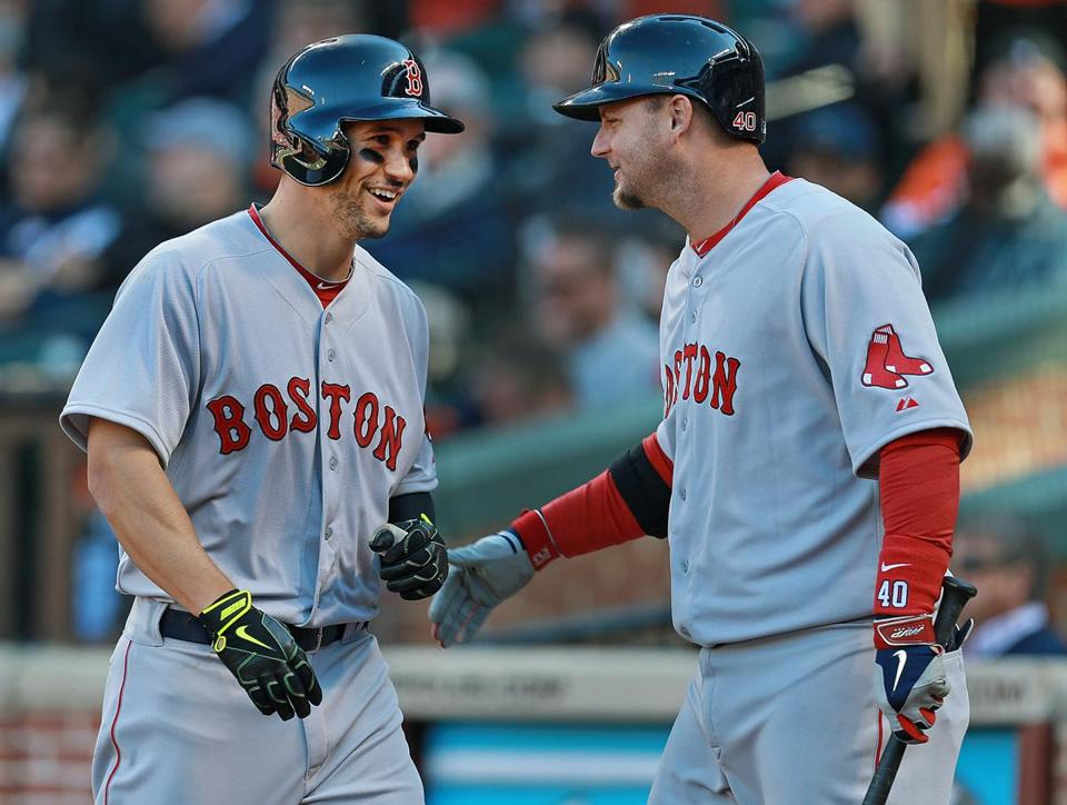 Grady Sizemore (left) is all smiles as he is greeted by A.J. Pierzynski following his fourth-inning homer. Jim Davis/Globe Staff