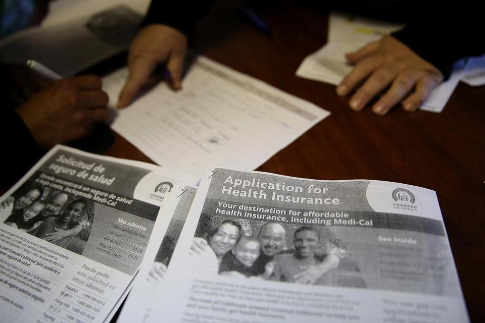 Informational pamphlets wee displayed during a health care enrollment fair in Richmond, Calif., on Monday.