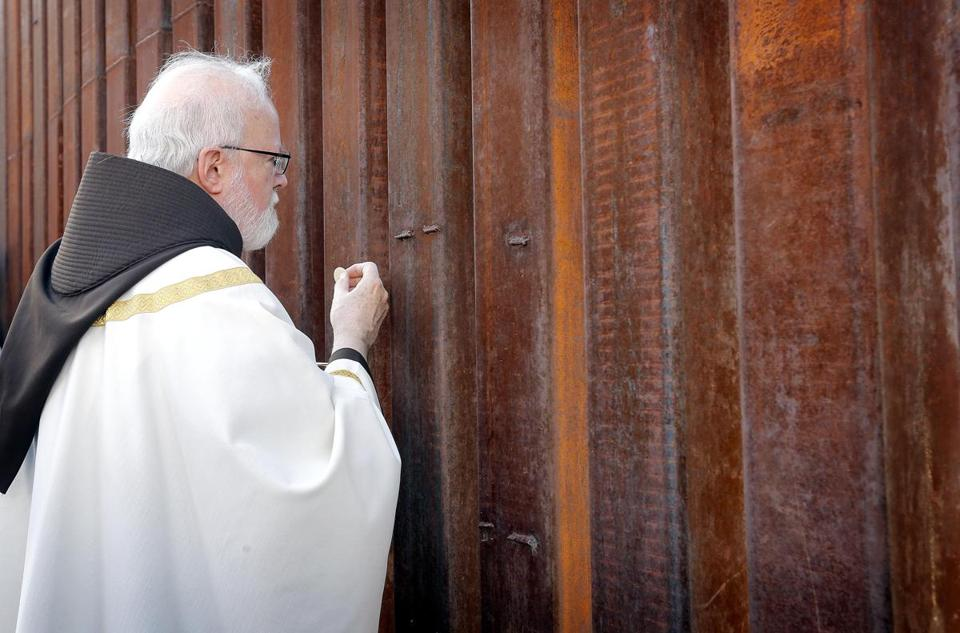 Cardinal Sean O'Malley offered communion to people on the Mexican side of the US-Mexico border.