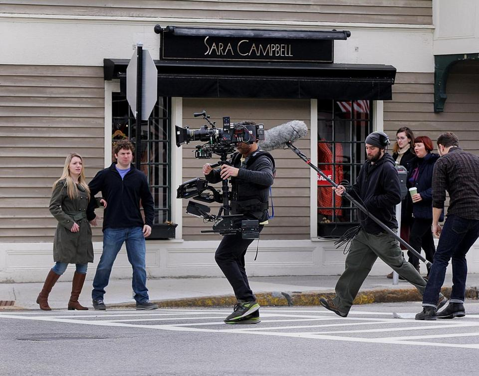 "Cast and crew from the movie ""Tumbledown"" use Concord Center as a backdrop while filming a street scene Wednesday morning."