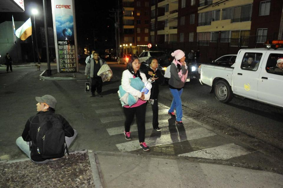 People evacuated their homes in Iquique, Chile, on Thursday after a strong aftershock struck nearby.