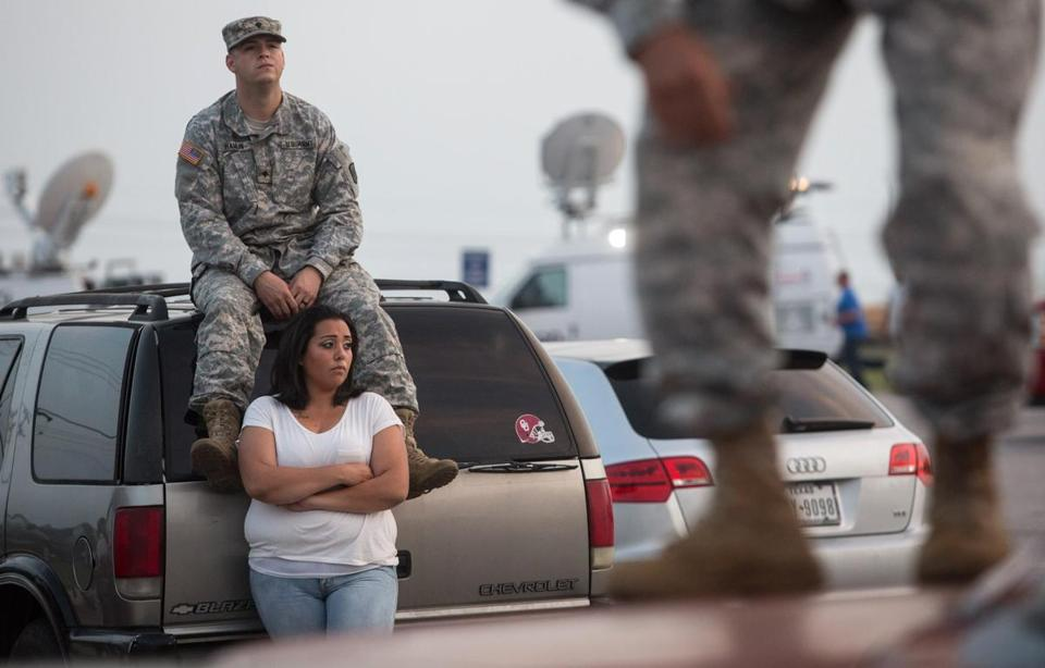 Lucy Hamlin and her husband, Spc. Timothy Hamlin, waited for permission to re-enter the Fort Hood military base, where they live, following a shooting on base.