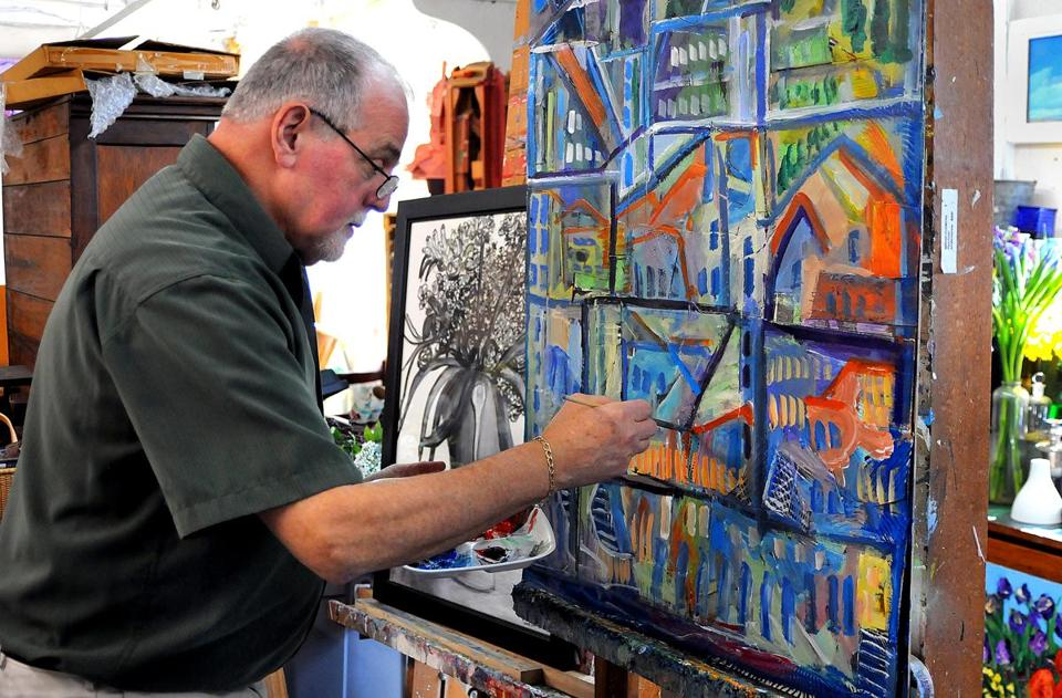 "Paul Crimi of Pembroke works on a painting in his studio in Rockland.  ""My art is the best way to express my appreciation for the joy and happiness . . .  in my life,"" he says."