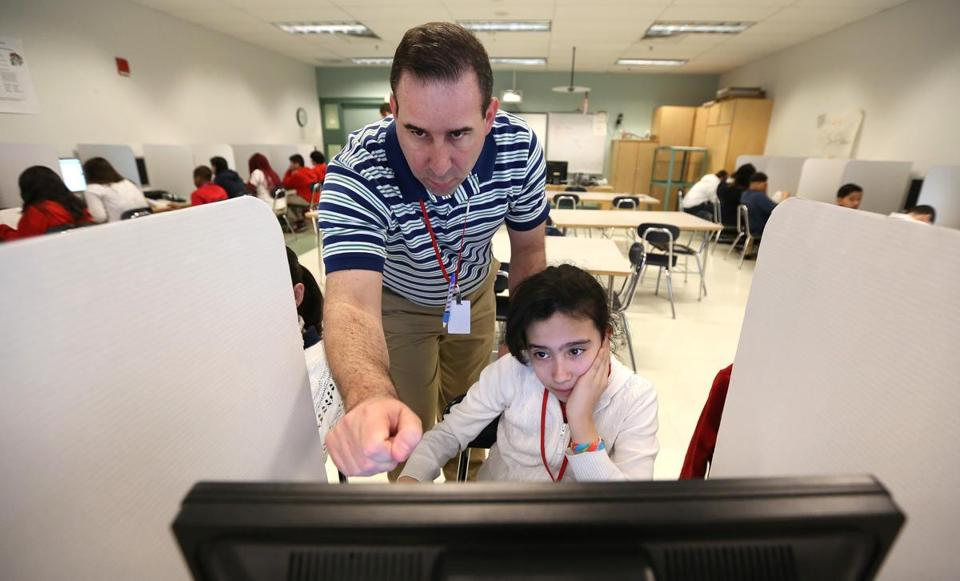 In Revere, teacher Joe Amico guided Ashley Lemus as she took the PARCC test.