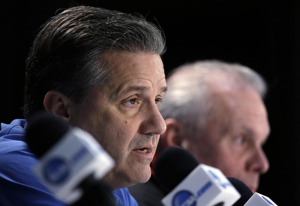 Kentucky coach John Calipari participates in a joint news conference Thursday with Wisconsin's Bo Ryan (rear).