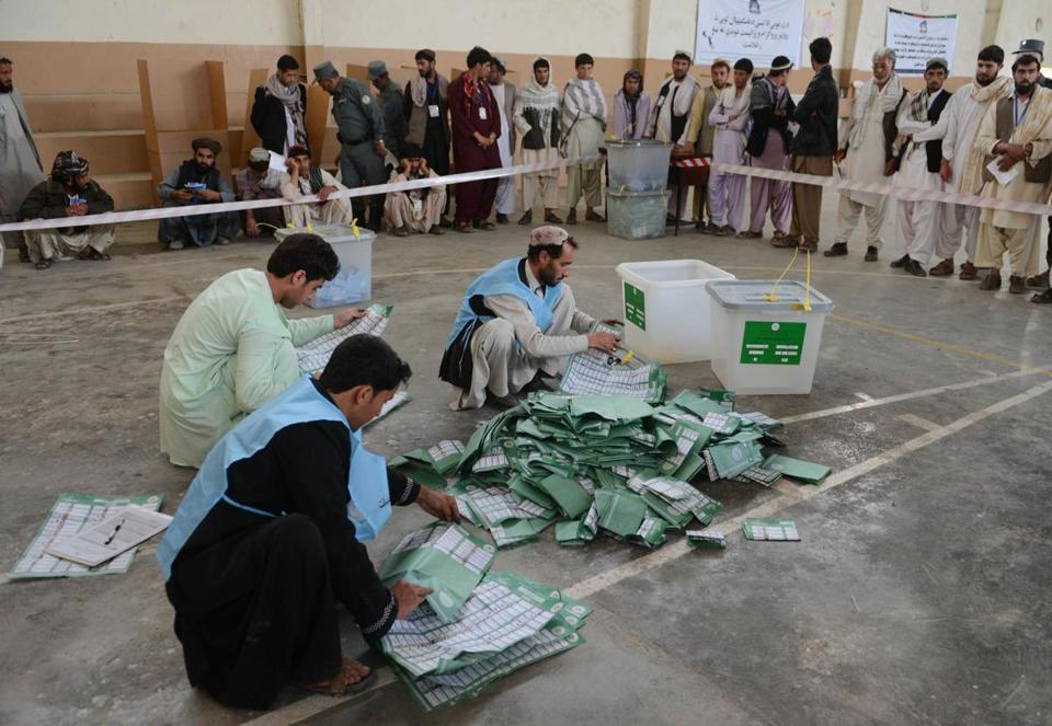 Afghan election officials counted ballots at the end of polling in Kandahar.