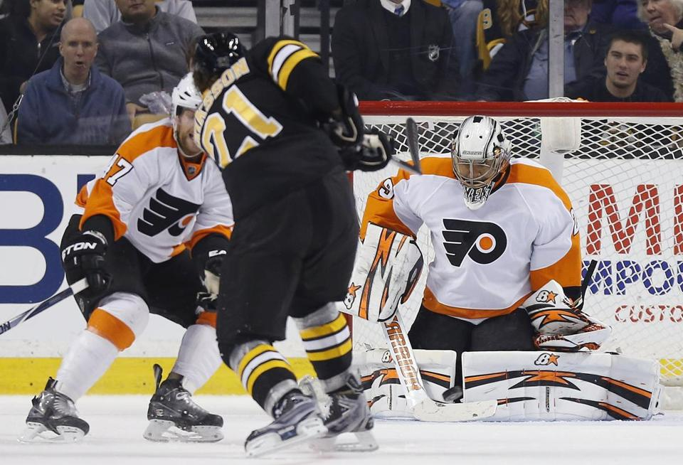 Ray Emery blocks a shot by Loui Eriksson in the third period, but Eriksson had four assists. Michael Dwyer/Associated Press