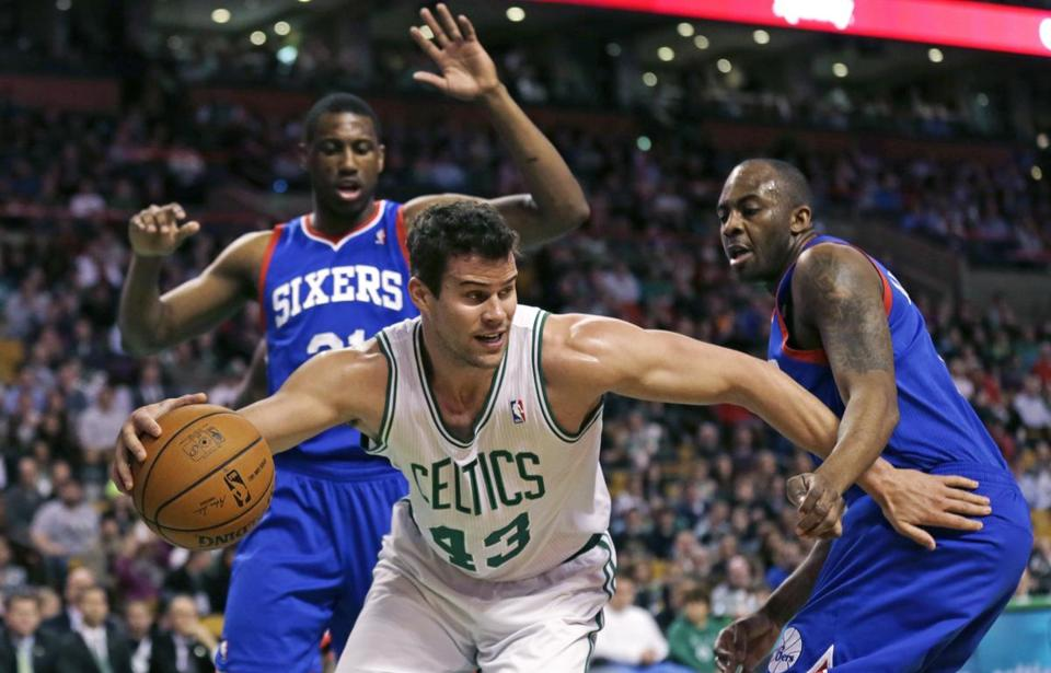 Kris Humphries (43) finds himself surrounded by the Sixers' Thaddeus Young (left) and James Anderson.