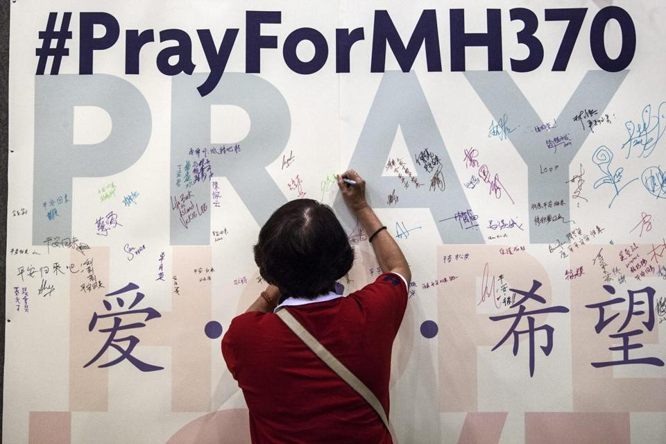 A woman wrote a message ahead of a mass prayer for the missing passengers and crew who were aboard the ill-fated Malaysia Airlines flight.