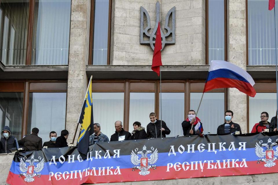 Pro-Russian protesters displayed a banner at the regional government building in Donetsk, in eastern Ukraine.