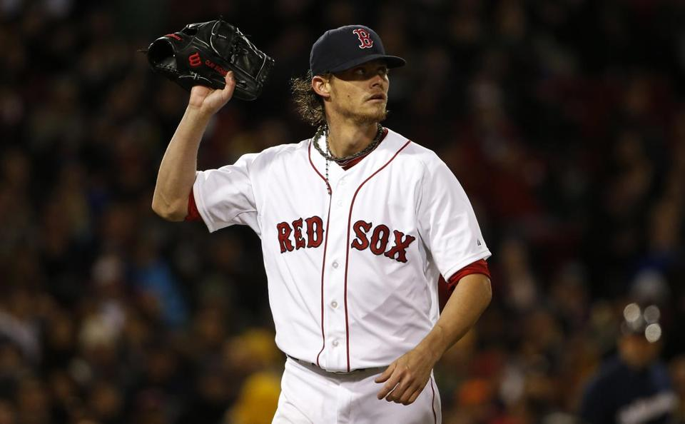Clay Buchholz left the mound after giving up three runs to the Brewers during the third inning.