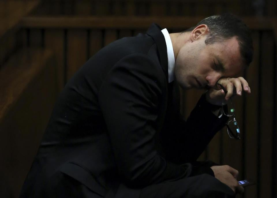 Oscar Pistorius reacts to testimony before taking the stand in his murder trial Monday. REUTERS/Themba Hadebe