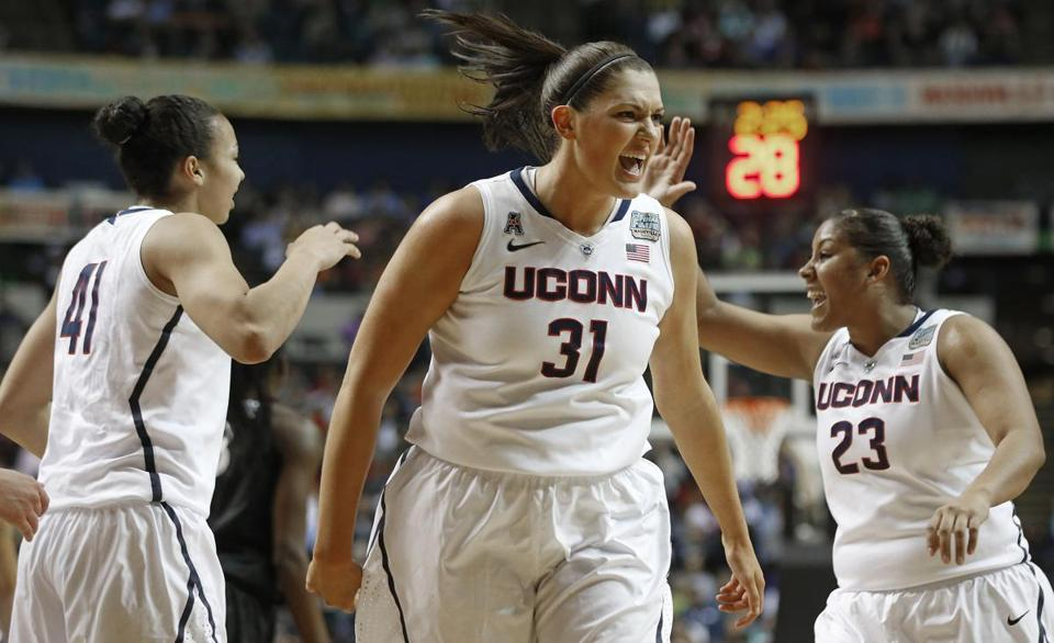 Connecticut center Stefanie Dolson (31) celebrates against Stanford during the first half of the semifinal game in the Final Four of the NCAA women's college basketball tournament.